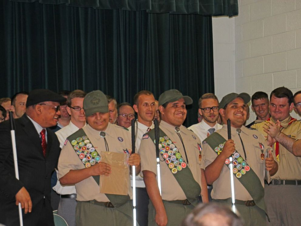PHOTO: Nick, Leo and Steven Cantos are all smiles during their Boy Scouts badge ceremony.
