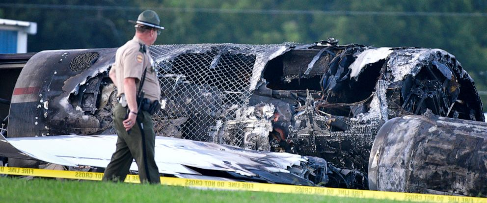 PHOTO: A police officer walks past the wreckage of a plane crash involving NASCAR driver Dale Earnhardt Jr. and his family, who survived the incident, in Elizabethton, Tennessee, U.S. August 15, 2019. REUTERS/Charles Mostoller