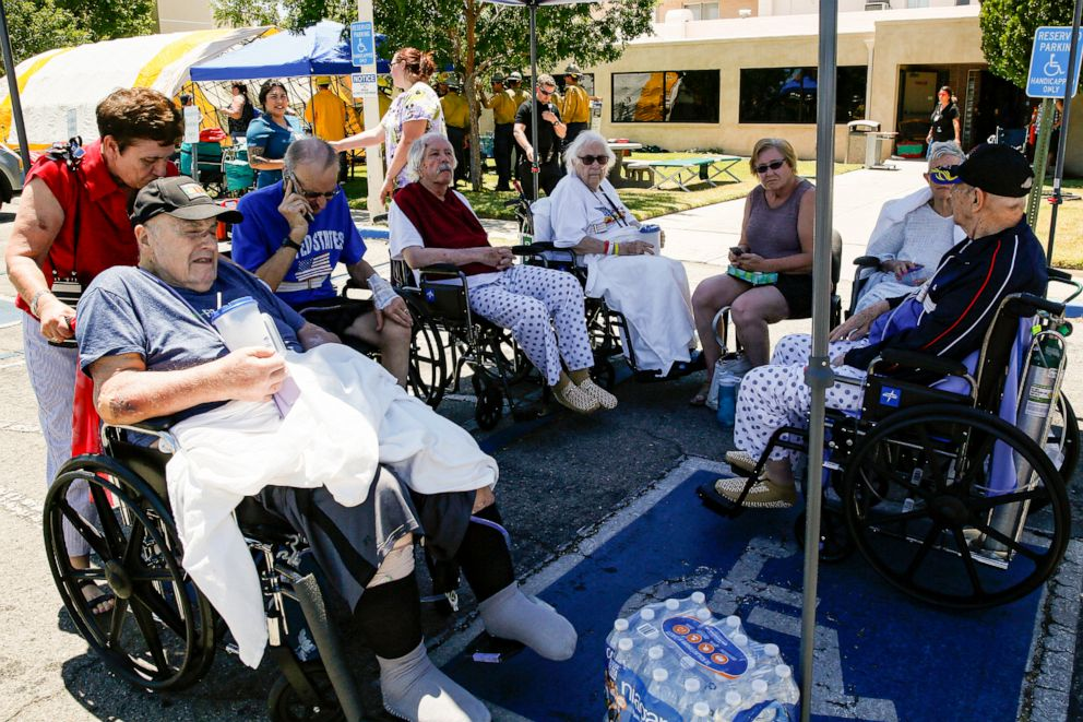 PHOTO: Evacuated patients rest under a shade of tent after being evacuated from Ridgecrest Regional Hospital after city was hit by a 6.4 earthquake July 04, 2019, in Ridgecrest, Calif.