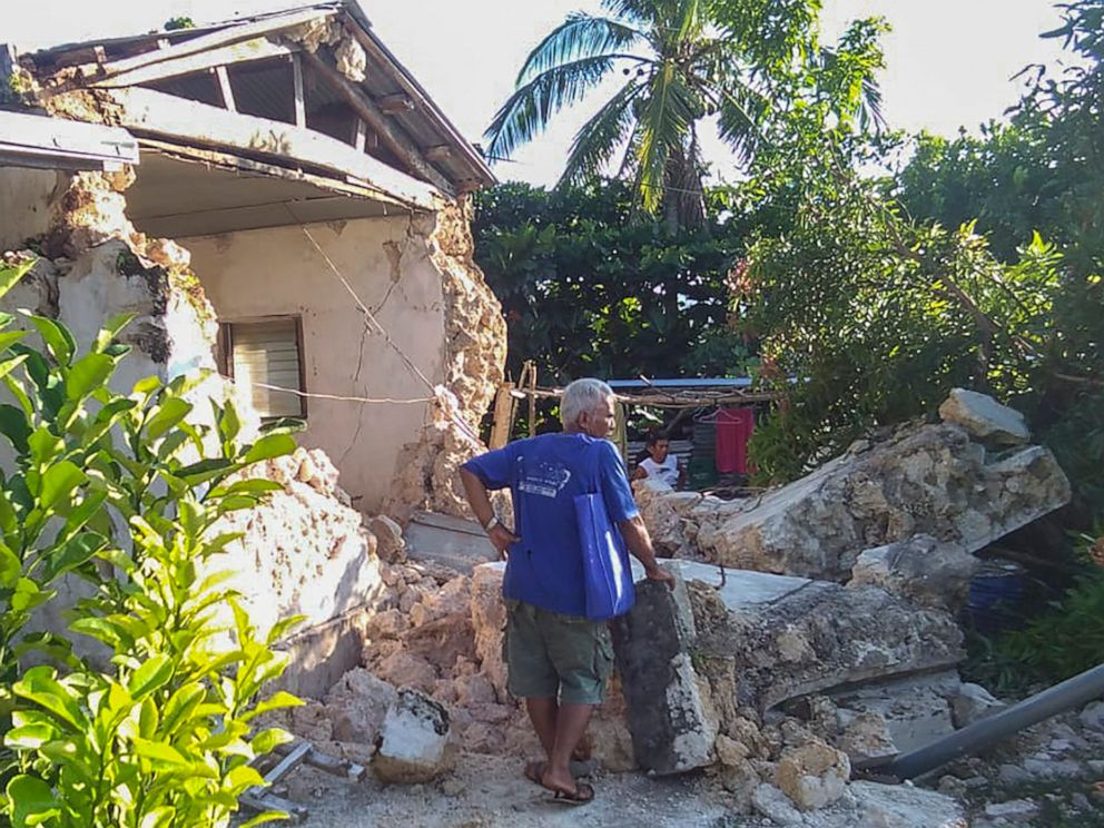 PHOTO: A resident looks at damaged houses after two earthquakes struck in Itbayat town, Batanes islands, northern Philippines, July 27, 2019.