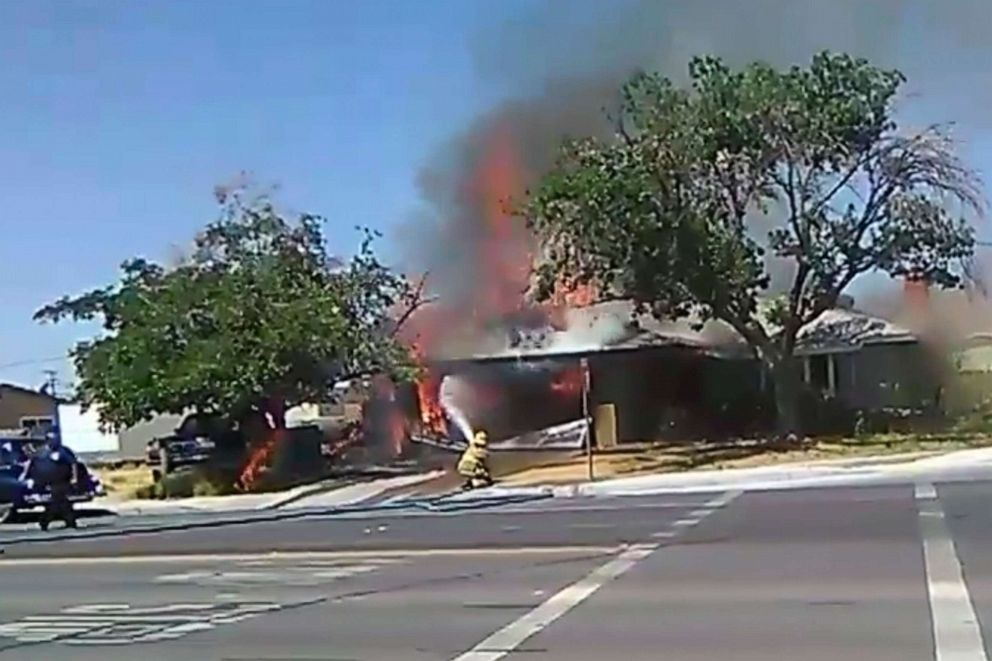 PHOTO: In this image taken from video provided by Ben Hood, a firefighter works to extinguish a fire, Thursday, July 4, 2019, following an earthquake in Ridgecrest, Calif.