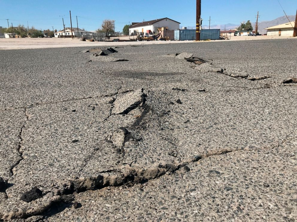 PHOTO: A road is damaged from an earthquake Thursday, July 4, 2019, in Trona, Calif.