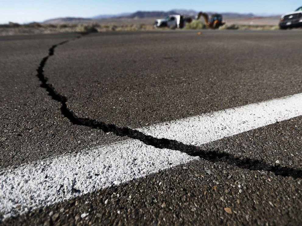 PHOTO: A crack stretches across the road after a 6.4 magnitude earthquake struck the area on July 4, 2019, near Ridgecrest, Calif.