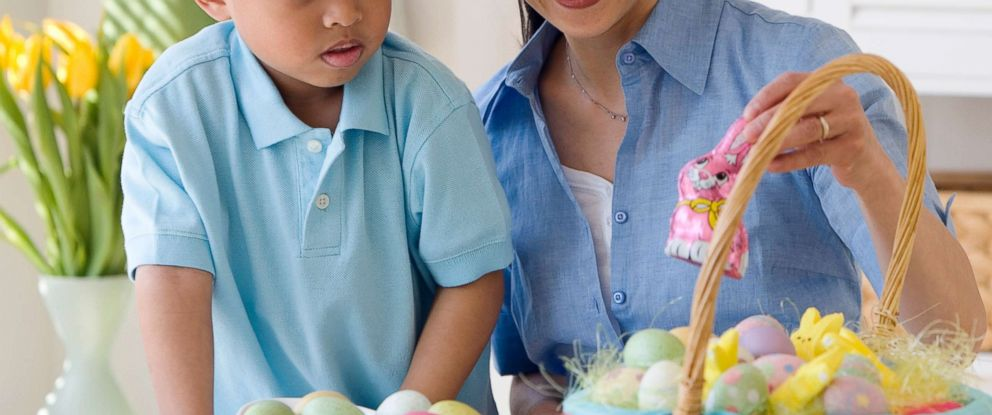 PHOTO: A woman looks at an Easter basket with a small child in an undated stock photo.