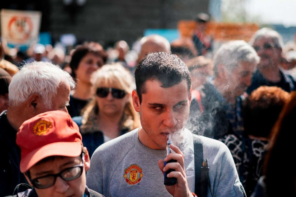 PHOTO: A man smokes an electronic cigarette during a protest in Sofia on April 11, 2018.