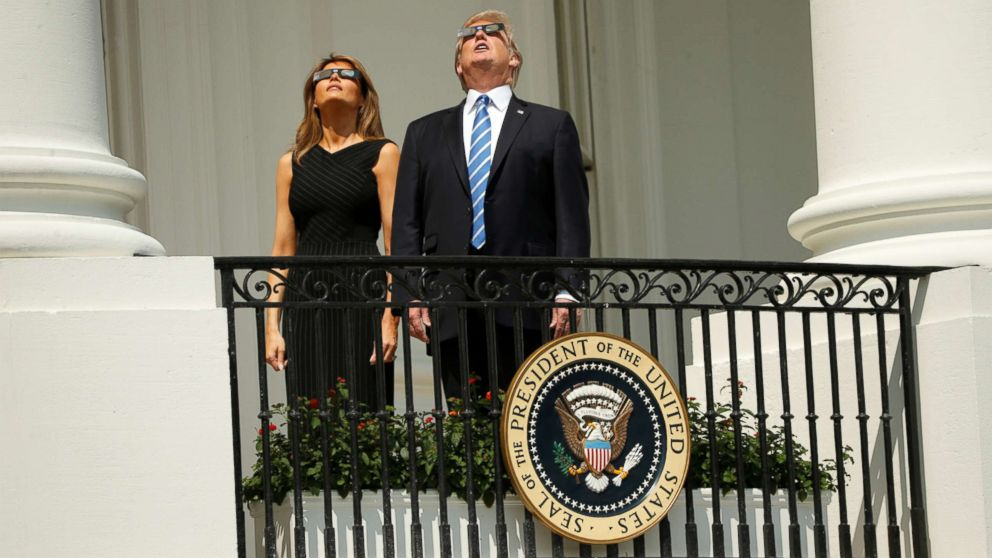 President Donald Trump watches the solar eclipse with first Lady Melania Trump from the Truman Balcony at the White House, Aug. 21, 2017.