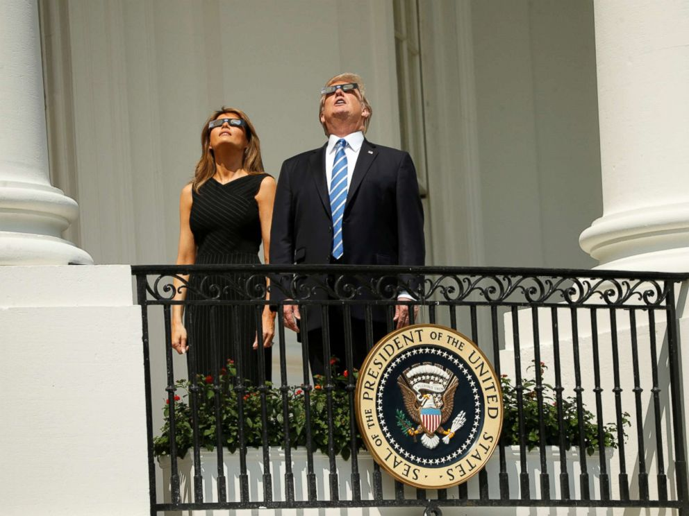 PHOTO: President Donald Trump watches the solar eclipse with first Lady Melania Trump from the Truman Balcony at the White House, Aug. 21, 2017.