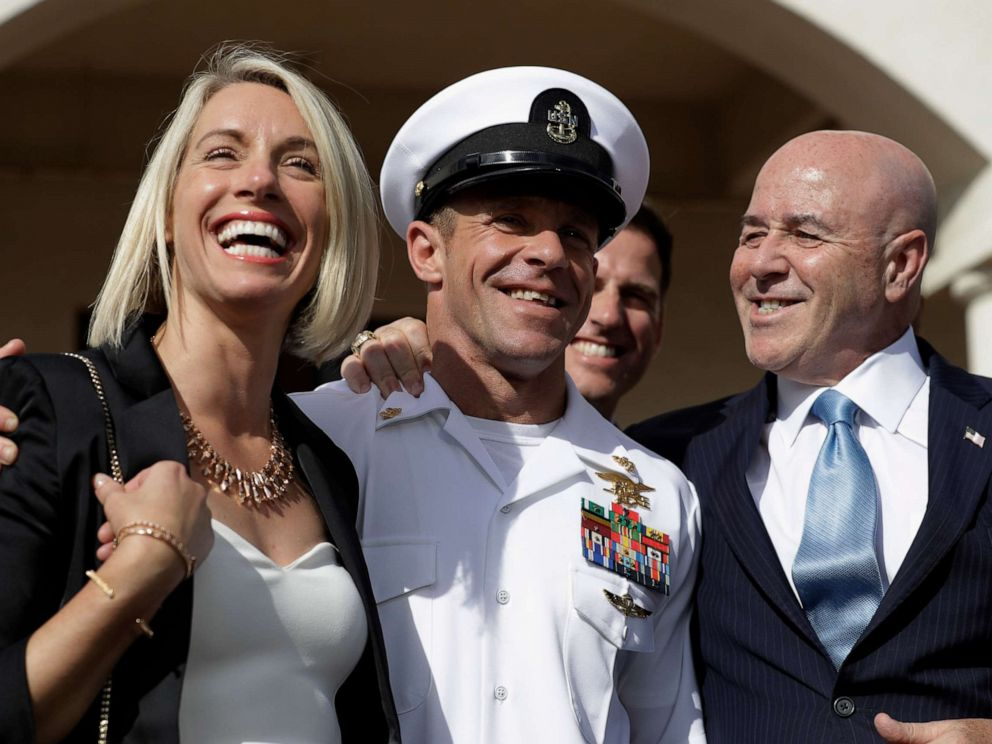 PHOTO: Navy Special Operations Chief Edward Gallagher, center, walks with his wife, Andrea Gallagher, left, and advisor, Bernard Kerik as they leave a military court on Naval Base San Diego, July 2, 2019, in San Diego.