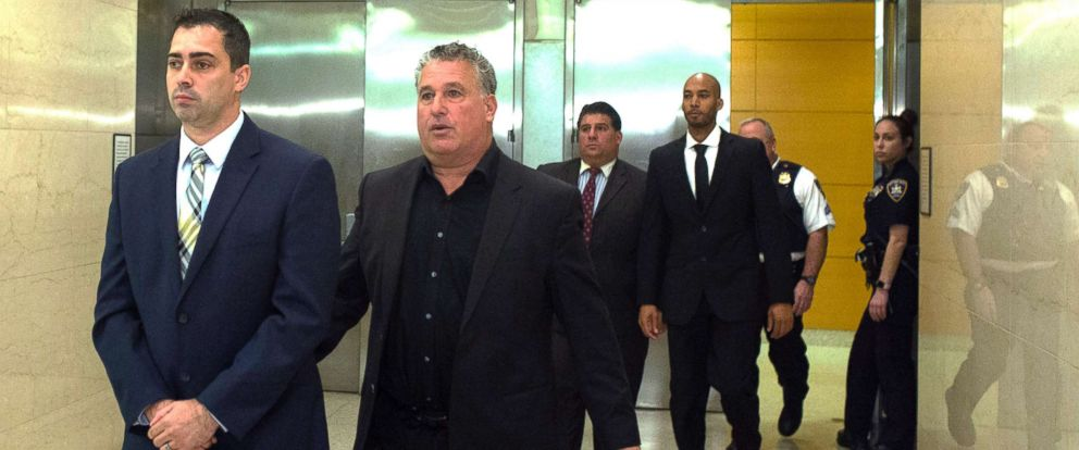 PHOTO: New York City police detectives Edward Martins, left, and Richard Hall, right, are escorted out of Kings County Supreme Court in Brooklyn, Oct. 30, 2017.