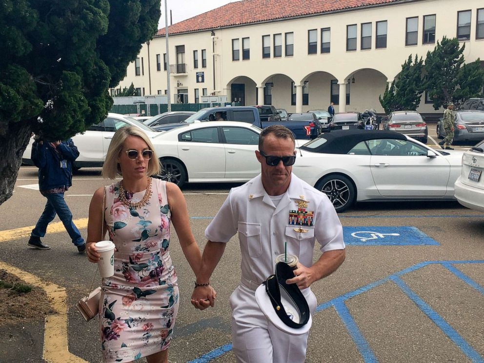 PHOTO: Navy Special Operations Chief Edward Gallagher walks with his wife, Andrea Gallagher, left, as they arrive on Naval Base San Diego, June 20, 2019.