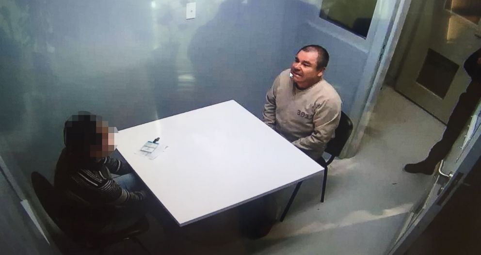 PHOTO: Handout picture released by the Mexican Interior Ministry on January 20, 2017, shows Joaquin Guzman Loera aka El Chapo Guzman, right, sitting in a chair as he is extradited to the United States on January 19, 2017, in an unknown location.