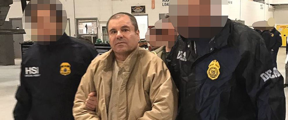 "PHOTO: This file handout photo obtained, Jan. 20, 2017, released by the Mexican Interior Ministry, shows Joaquin Guzman Loera aka ""El Chapo"" Guzman escorted in Ciudad Juarez by the Mexican police as he is extradited to the United States."