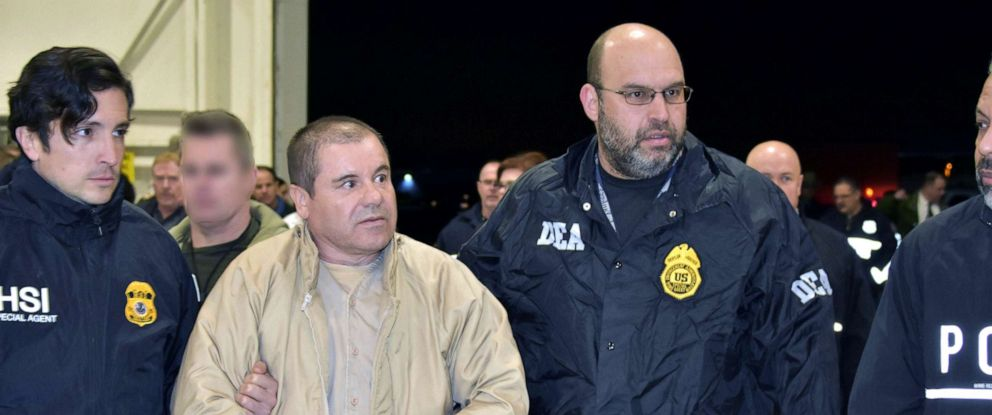 "PHOTO: Mexican drug baron Joaquin ""El Chapo"" Guzman, one of the worlds most notorious criminals, is extradited to the United States to face charges."