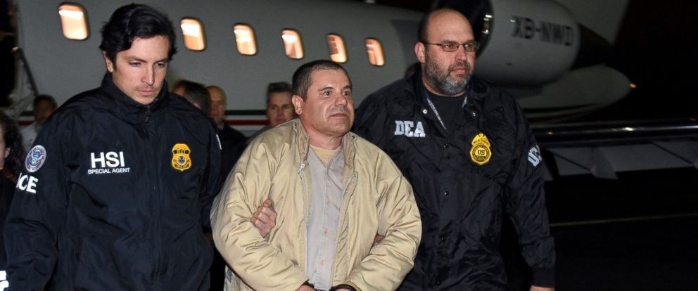 """PHOTO: In this Jan. 19, 2017 file photo provided U.S. law enforcement, authorities escort Joaquin """"El Chapo"""" Guzman, center, from a plane to a waiting caravan of SUVs at Long Island MacArthur Airport, in Ronkonkoma, N.Y."""