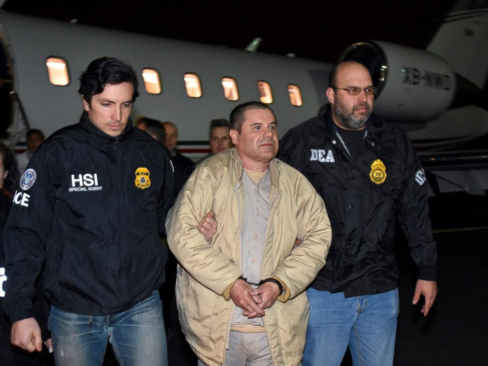 PHOTO: In this Jan. 19, 2017 file photo provided U.S. law enforcement, authorities escort Joaquin El Chapo Guzman, center, from a plane to a waiting caravan of SUVs at Long Island MacArthur Airport, in Ronkonkoma, N.Y.