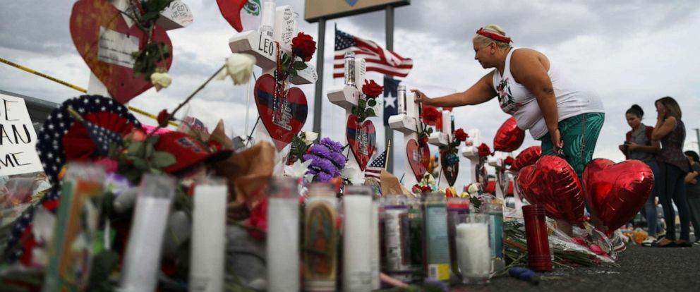 PHOTO: A woman touches a cross at a makeshift memorial for victims outside Walmart, near the scene of a mass shooting which left at least 22 people dead, on Aug. 6, 2019 in El Paso, Texas.