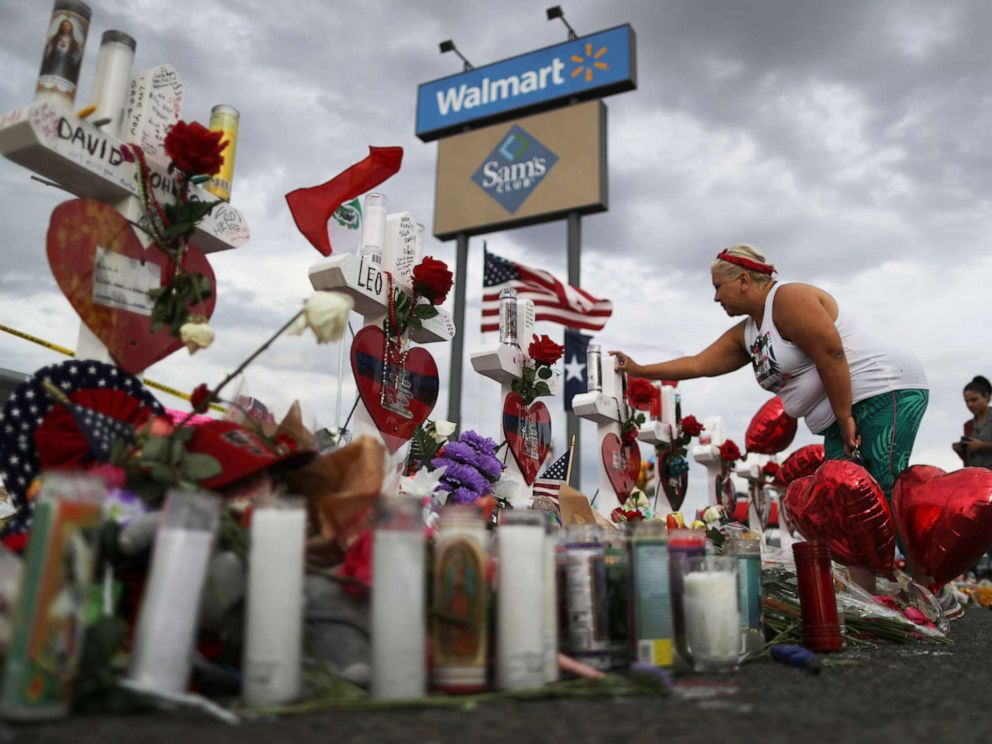 PHOTO: A woman touches a cross at a makeshift memorial for victims outside Walmart, near the scene of a mass shooting which left at least 22 people dead, on Aug. 6, 2019, in El Paso, Texas.