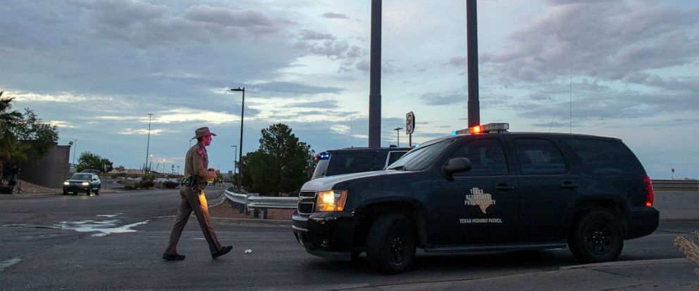 PHOTO:A Texas State Trooper walks back to his car while providing security outside the Walmart store in the aftermath of a mass shooting in El Paso, Texas, , Aug. 4, 2019.