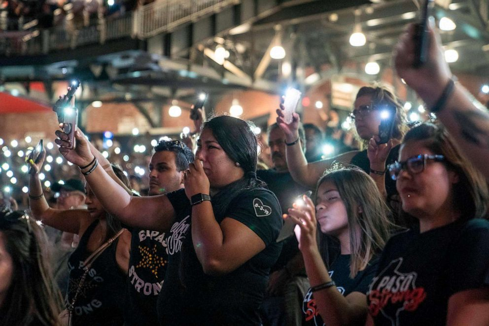 PHOTO: Attendees hold up the flashlights on their phones during a community memorial service for the 22 victims of the mass shooting at Southwest University Park in El Paso, Texas, Aug. 14, 2019.