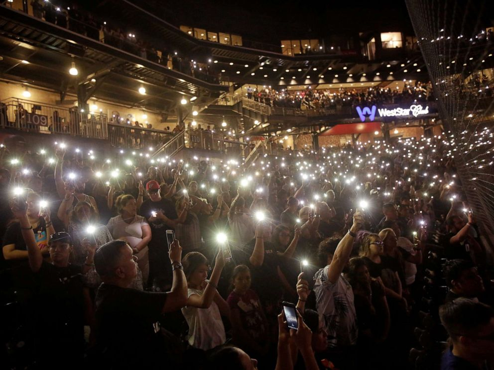 PHOTO: People take part in a memorial at Southwest University Park for the victims of a shooting at a Walmart store in El Paso, Texas, Aug. 14, 2019.