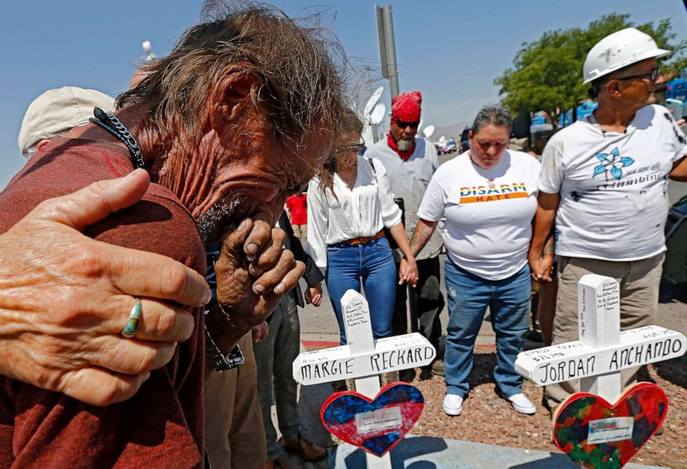 PHOTO: Antonio Basco cries while standing next to the cross for his partner Margie Reckard at the make shift memorial for the mass shooting at a Walmart in El Paso, Texas, Aug. 5, 2019.