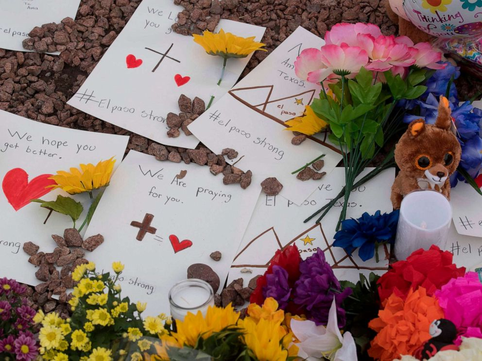 PHOTO: Messages and flowers at a makeshift memorial outside the Cielo Vista Mall Wal-Mart, Aug. 4, 2019, where a shooting left 20 people dead in El Paso, Texas.