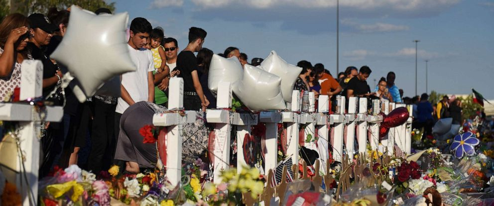PHOTO: People gather to pay their respects at a growing memorial three days after a mass shooting at a Walmart store in El Paso, Texas, August 6, 2019