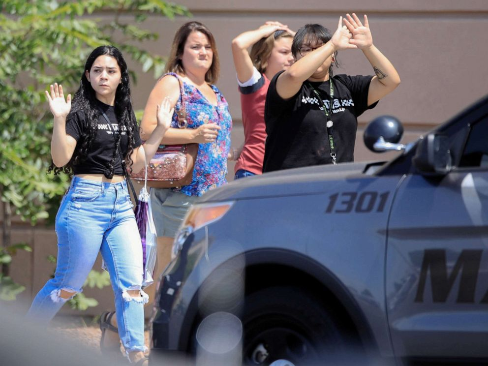 PHOTO: Shoppers exit with their hands up after a mass shooting at a Walmart in El Paso, Texas, Aug. 3, 2019.