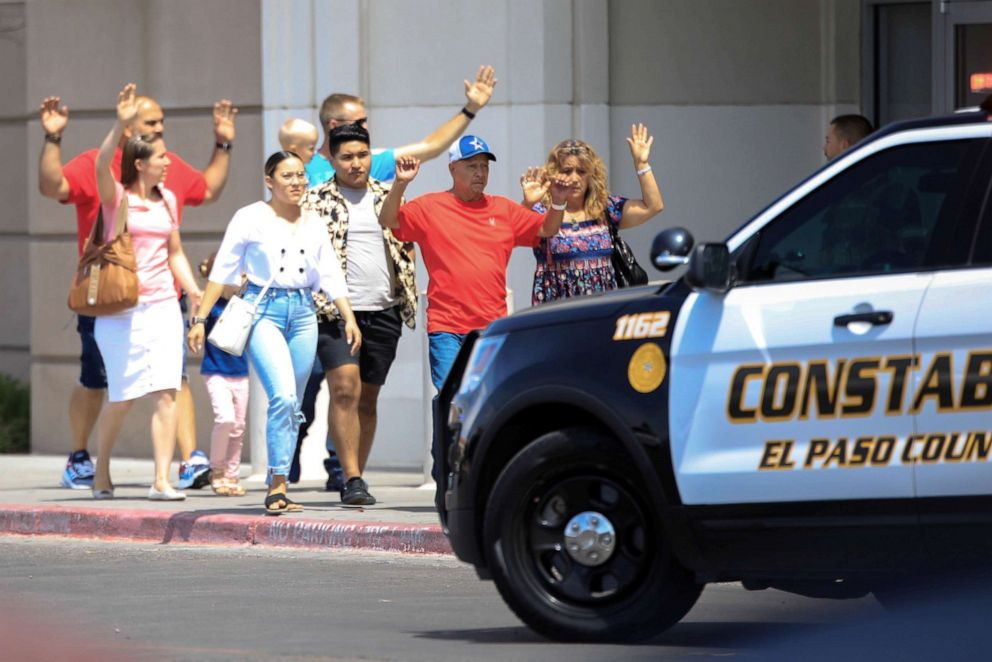 PHOTO: Shoppers exit after a mass shooting at a Walmart in El Paso, Texas, Aug. 3, 2019.