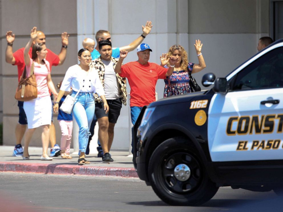 Reuters FILE Shoppers exit after a mass shooting at a Walmart in El Paso Texas Aug. 3 2019