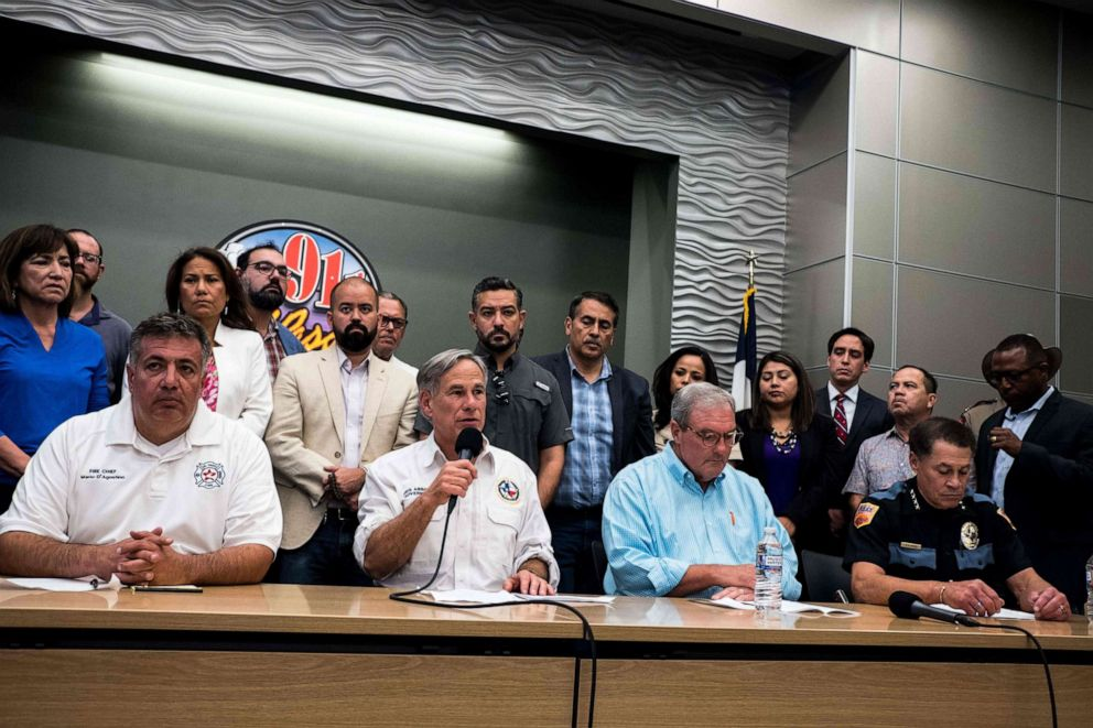 PHOTO: Texas Governor Greg Abbott, joined by El Paso city officials, speaks during a press briefing following a mass fatal shooting, at the El Paso Regional Communications Center in El Paso, Texas, Aug. 3, 2019.