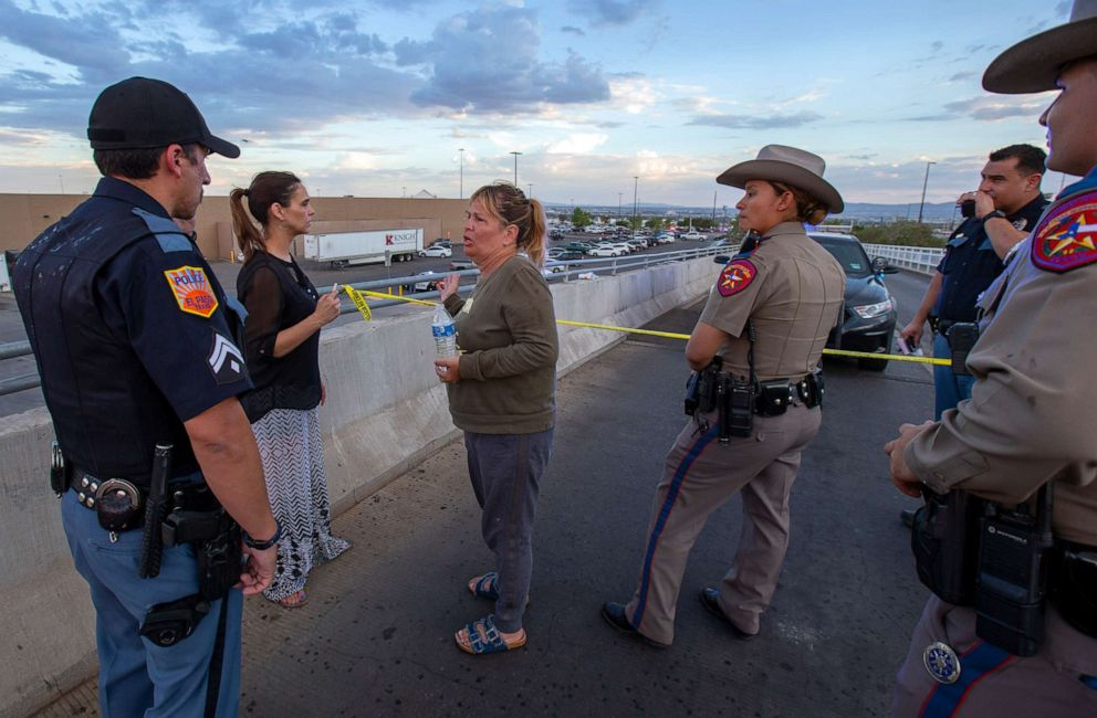 PHOTO: Edie Hallberg, center, speaks with police officers outside the Walmart store as shes looking for her missing mother Angie Englisbee, 87, who was in the store during the shooting in El Paso, Texas, Aug. 3, 2019.
