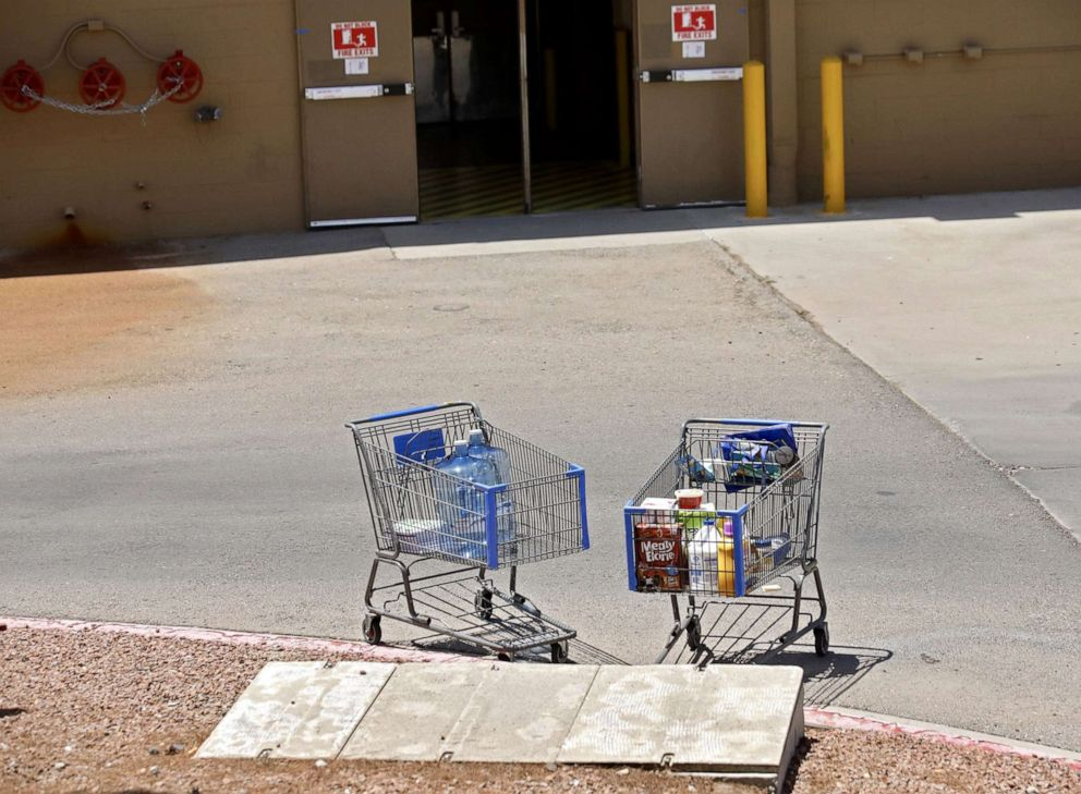 PHOTO: Shopping carts sit next to a curb after a shooting at a Walmart in El Paso, Texas, Aug. 3, 2019.