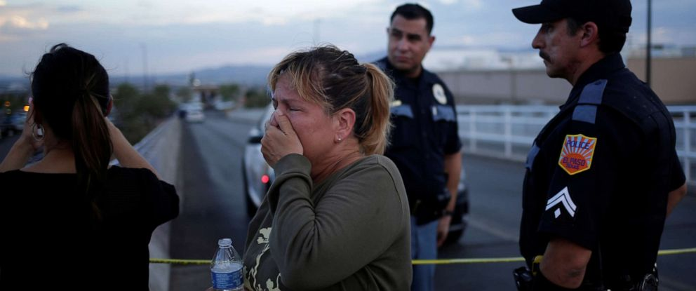 PHOTO: A woman reacts while trying to find her mother after a mass shooting at a Walmart in El Paso, Texas, Aug. 3, 2019.