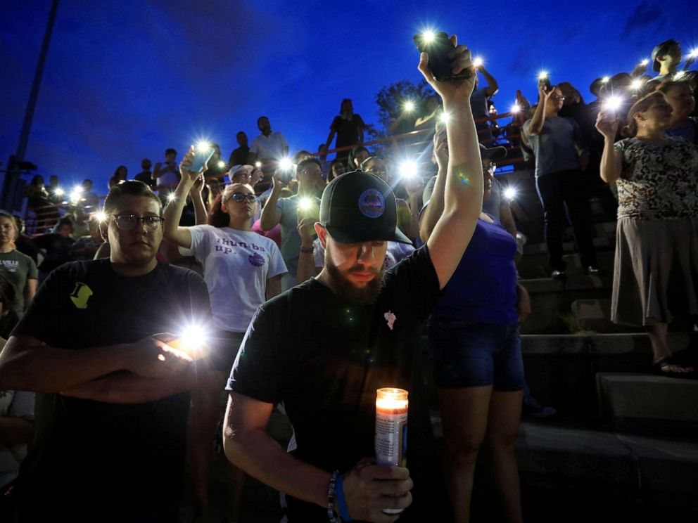 PHOTO: Francisco Castaneda joins mourners taking part in a vigil at El Paso High School after a mass shooting at a Walmart store in El Paso, Texas, U.S. August 3, 2019. REUTERS/Jorge Salgado NO RESALES. NO ARCHIVES.