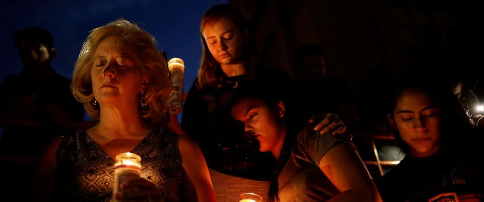 PHOTO: Mourners take part in a vigil at El Paso High School after a mass shooting at a Walmart store in El Paso, Texas, Aug. 3, 2019.