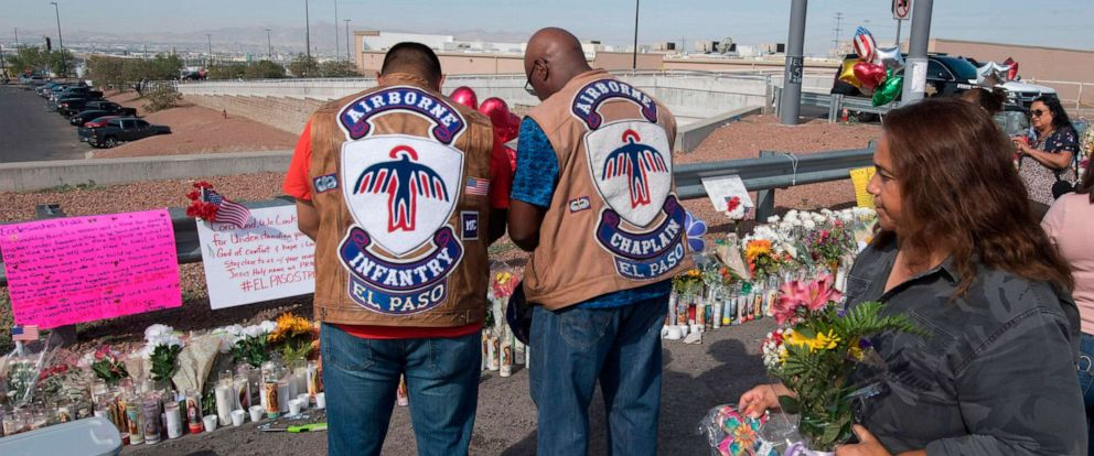 PHOTO: People pray at a makeshift memorial after the shooting that left at least 22 people dead at the Cielo Vista Mall WalMart in El Paso, Texas, Aug. 5, 2019.