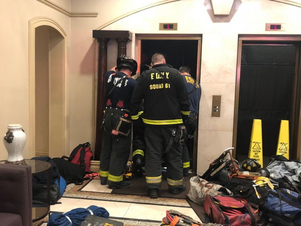 PHOTO: New York Fire Department members investigate an incident with an elevator in an apartment building in New York city.