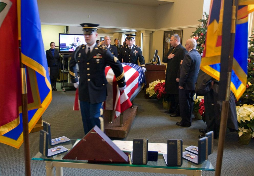 PHOTO: An honor guard escorts the flag-draped casket of U.S. Army Sgt. Elijah John-Miles Rao, 26, to a funeral service, Dec. 15, 2009, in Portland, Ore.