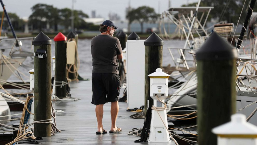 PHOTO: Lou Putney checks on sailboats for damages from Hurricane Elsa docked at the Davis Islands Yacht Club in Tampa, Florida, U.S., July 7, 2021.