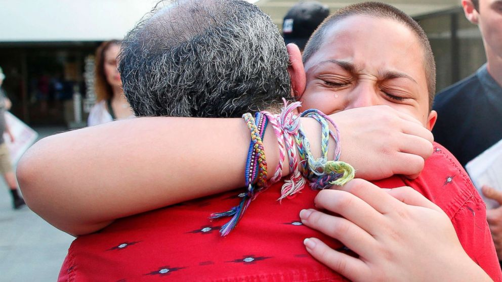 Marjory Stoneman Douglas High School student Emma Gonzalez hugs her father Jose after speaking at a rally for gun control at the Broward County Federal Courthouse in Fort Lauderdale, Fla., Feb. 17, 2018.