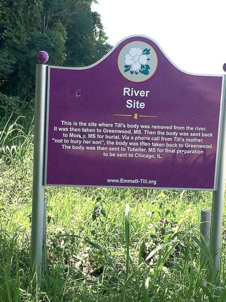 PHOTO: Four bullet holes are seen through the River Site marker where Emmett Tills body was recovered in 1955.