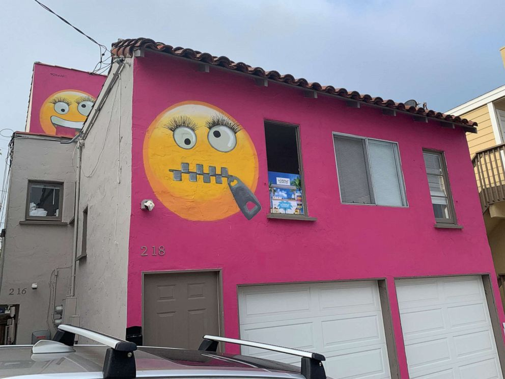 PHOTO: Painted emoji are seen on a house in Manhattan Beach, Calif., Aug. 7, 2019. The Southern California seaside community is in an uproar after the home was given the new paint job featuring two huge emojis on a bright pink background.