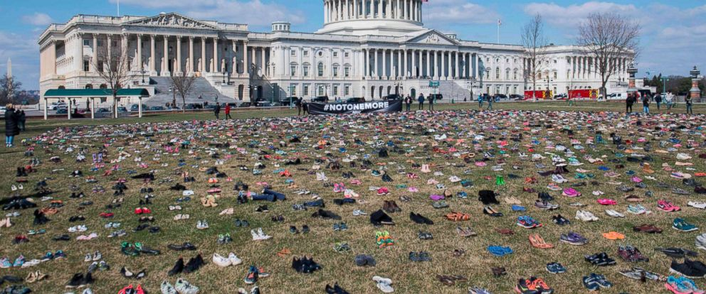 PHOTO: The lawn outside the U.S. Capitol is covered with 7,000 pairs of empty shoes to memorialize the 7,000 children killed by gun violence since the Sandy Hook school shooting, in Washington, March 13, 2018.