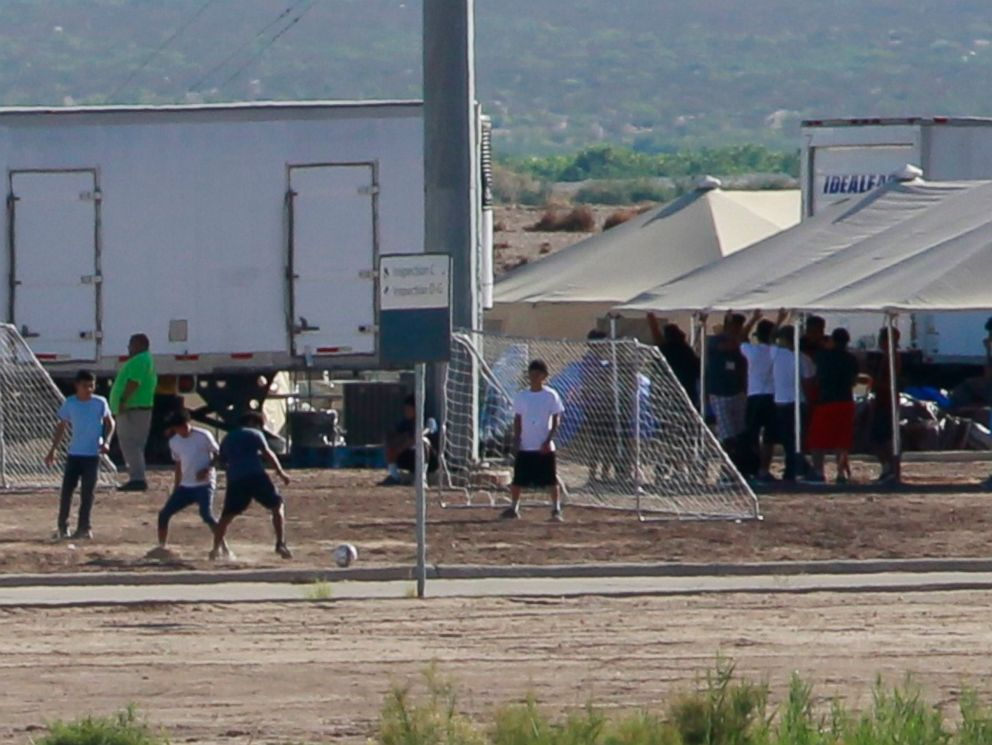 PHOTO: Children of detained migrants play soccer at a newly constructed tent encampment as seen through a border fence near the U.S. Customs and Border Protection port of entry in Tornillo, Texas, June 18, 2018.