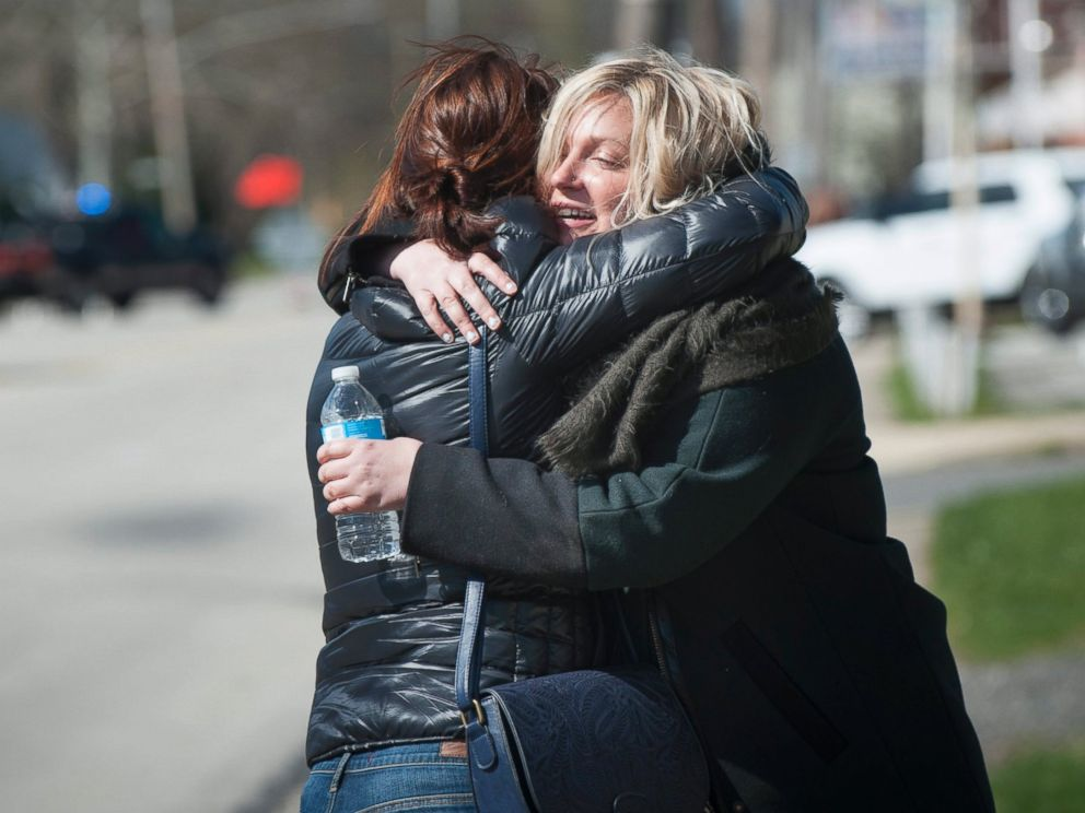 PHOTO: A passenger hugs her friend after Amtraks Palmetto Train 89 collided with a backhoe in Chester, Pennsylvania, April 3, 2016.