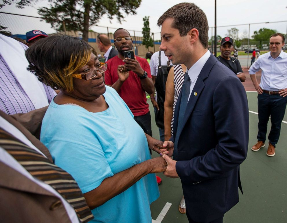 PHOTO: South Bend Mayor and Democratic presidential candidate Pete Buttigieg shares a moment with Shirley Newbill, mother of Eric Logan, during a gun violence memorial at the Martin Luther King Jr. Recreation Center in South Bend, Ind.