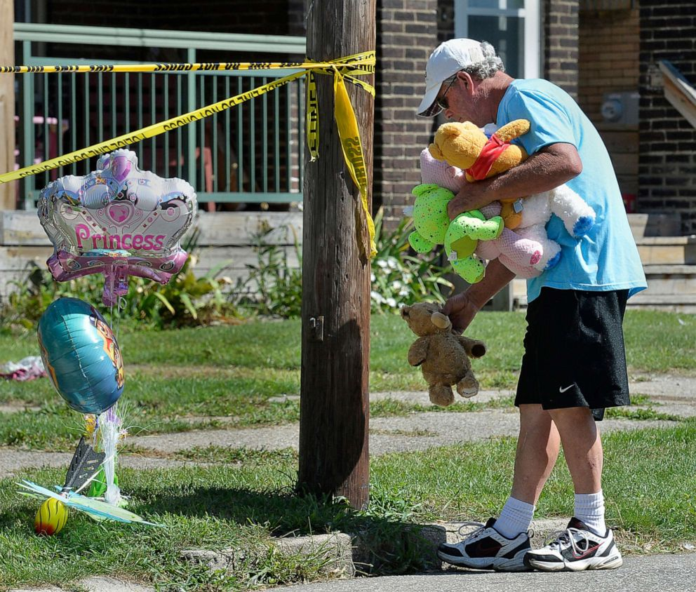 PHOTO: Paul Laughlin, 57, places stuffed animals outside a home at 1248 West 11th St. in Erie, Pa., where multiple people died in an early-morning fire, Aug. 11, 2019.