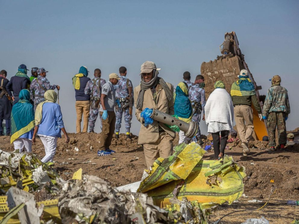 PHOTO: Workers gather at the scene of an Ethiopian Airlines flight crash near Bishoftu, south of Addis Ababa, Ethiopia, March 11, 2019.