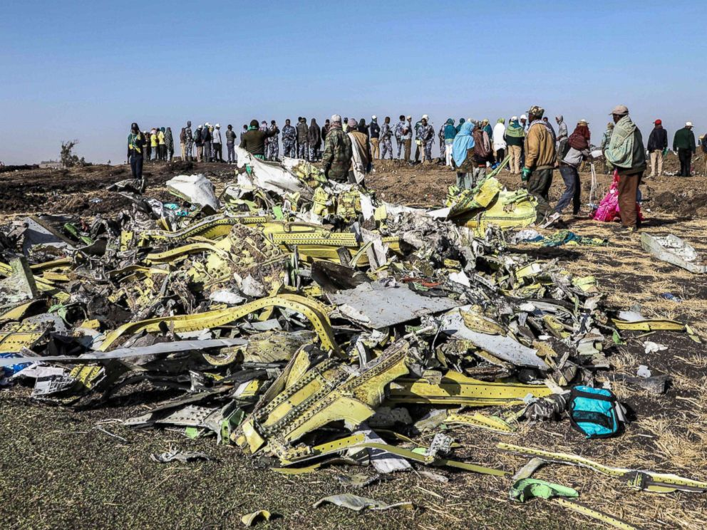 PHOTO: People stand near collected debris at the crash site of Ethiopia Airlines near Bishoftu, southeast of Addis Ababa, Ethiopia, March 11, 2019.
